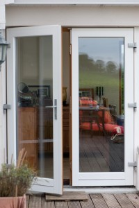 78Cora aluclad timber French doors_Eiche_ Afzelia stain interior-RAL 9016 exterior